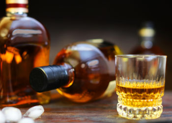 whisky glass with bottles